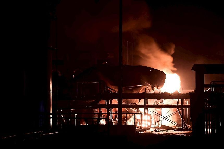 Smoke rising at the site of a blast in a factory in Huantai, a county in Zibo city, in China's Shandong province. The explosion, which occurred on Saturday night, ripped through a chemical plant, killing one person and injuring nine, China's official