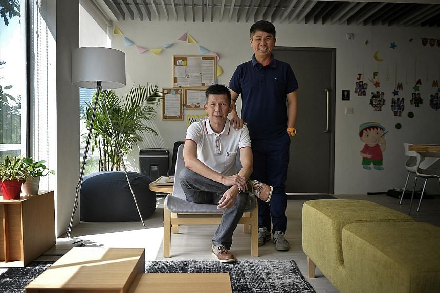 Mr Anthony Loh (seated) gained confidence and found a new job with social worker Brian Khor's help.