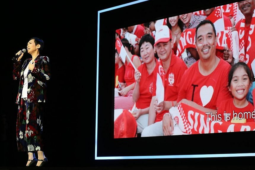 Kit Chan, singing Home just before Prime Minister Lee Hsien Loong's English speech at the National Day Rally yesterday. The home-grown singer is the first to perform at the annual address.