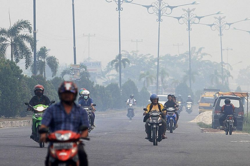 Haze from forest fires enveloping Pekanbaru in Sumatra this year. The haze issue is a sensitive one between Singapore and Indonesia.