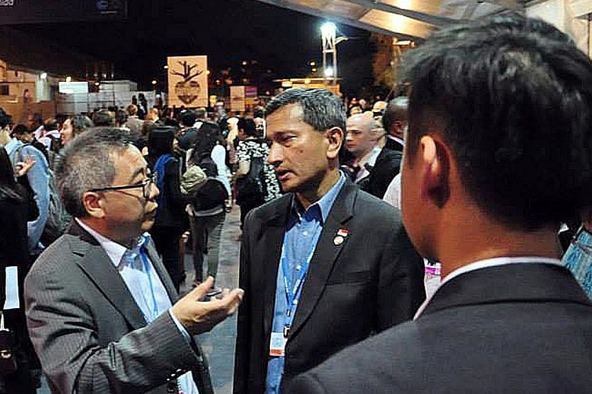 Two ministers who have shown Singapore's worth on a global stage are Environment and Water Resources Minister Vivian Balakrishnan (in the centre of photo on the right) at the UN Climate Change Conference last year, and Manpower Minister Lim Swee Say