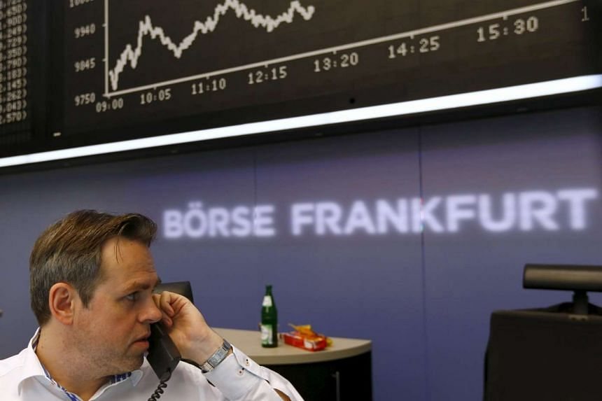 A trader works at his desk in front of the DAX board at the Frankfurt stock exchange, Germany, August 24, 2015. PHOTO: REUTERS