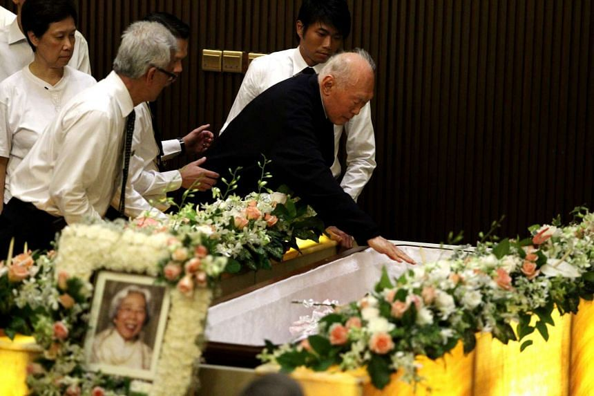Mr Lee Kuan Yew giving his wife, Madam Kwa Geok Choo, a  kiss during her funeral at the Mandai Crematorium on Oct 6, 2010. Mrs Lee passed away on Oct 2, 2010.