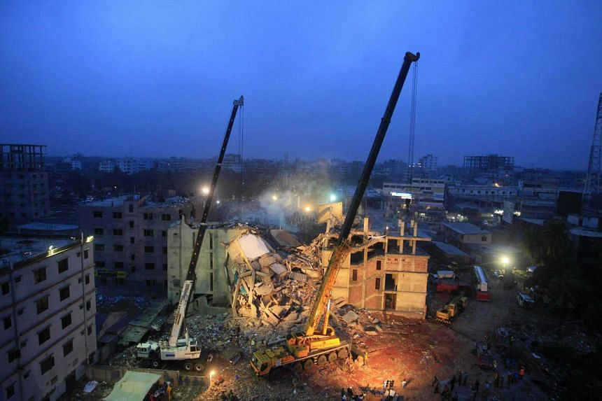Cranes operated by Bangladeshi Army personnel at the scene following the collapse of Rana Plaza.