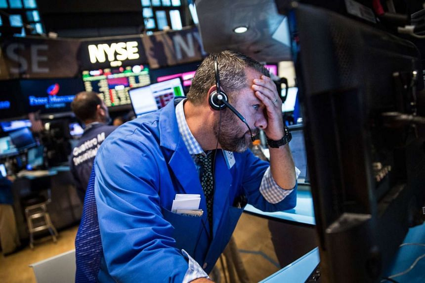 A trader works on the floor of the New York Stock Exchange on Aug 20, 2015 in New York City.
