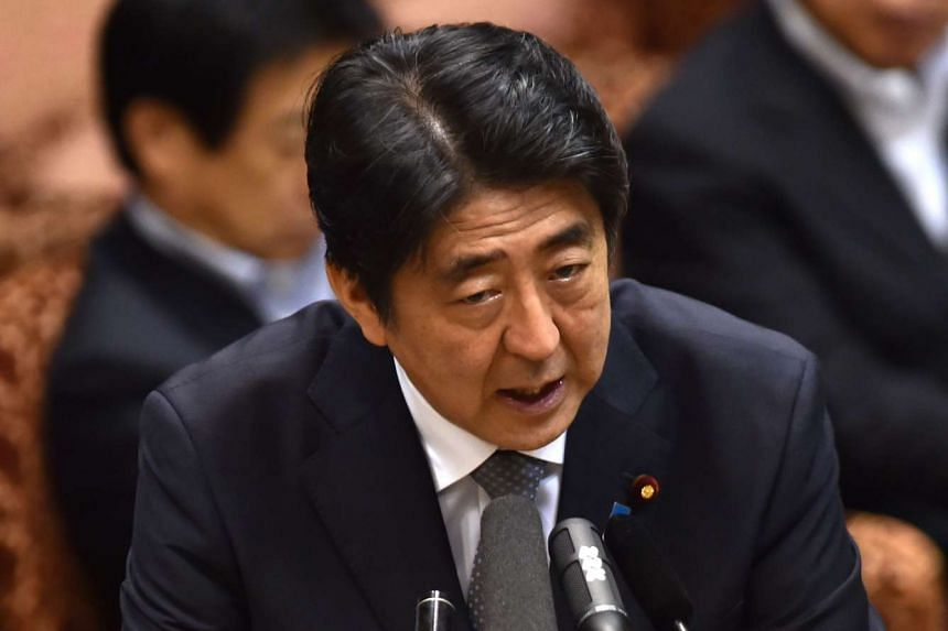 Japanese Prime Minister Shinzo Abe has criticised Russian Prime Minister Dmitry Medvedev over his visit to islands which have been part of a 70-year-old territorial dispute.