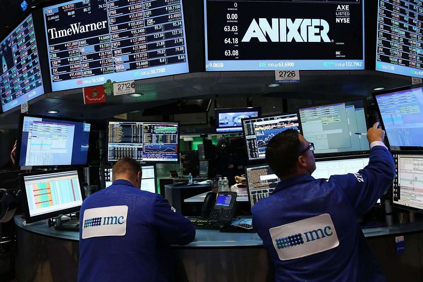 Traders work on the floor of the New York Stock Exchange (NYSE) in New York City.