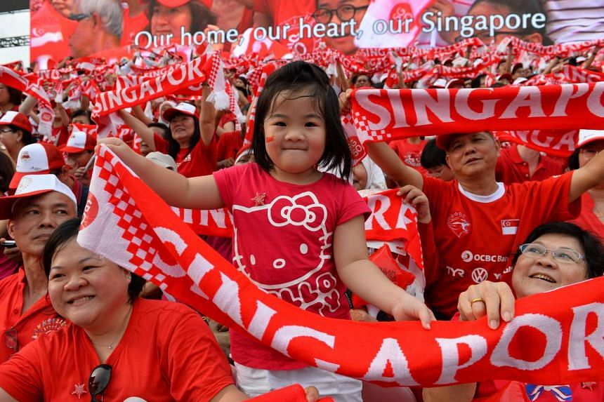 A girl enjoying the National Day Parade at the Padang on Aug 9, 2015. She was among some 1.7 million people who participated in the jubilee celebrations over the past four days.