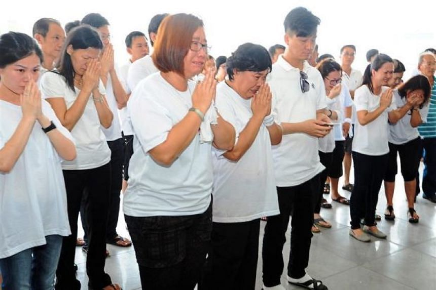 Family and friends paying their respects at the funeral of Ms Lim Soo See, a victim of the Aug 17 Bangkok blast , at the Berapit crematorium in Bukit Mertajam on Aug 23, 2015.