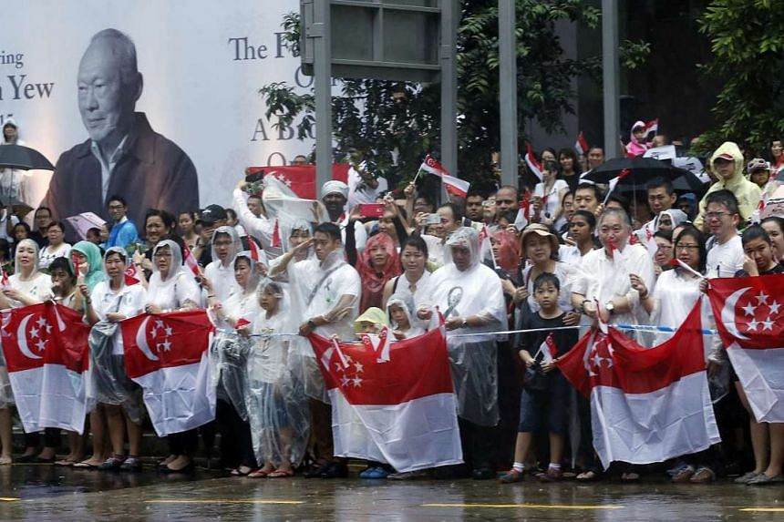 Crowds at the state funeral procession of former prime minister Lee Kuan Yew gathering outside NTUC Building on March 29, 2015.