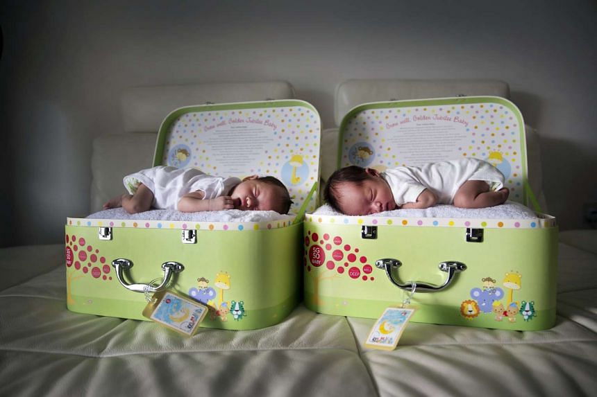 SG50 Jubilee twins Charlotte and Colette. PM Lee Hsien Loong unveiled a slew of pro-family measures, including an enhanced Baby Bonus scheme.