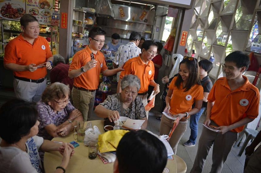 NSP organising secretary Spencer Ng says the party is still committed to contesting in MacPherson. Mr Ng (second from left) greeting  MacPherson residents earlier this month.