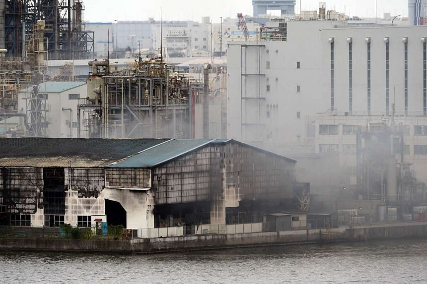 Smoke rising from a steel plant beside a river in Kawasaki near Tokyo's Haneda Airport on Aug 24, 2015.