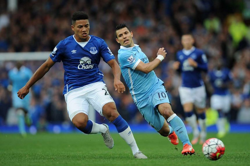 Manchester City's Sergio Aguero (right) in action with Everton's Tyias Browning (left) during the English Premier League soccer match between Everton and Manchester City at Goodison Park, Liverpool on Sunday.