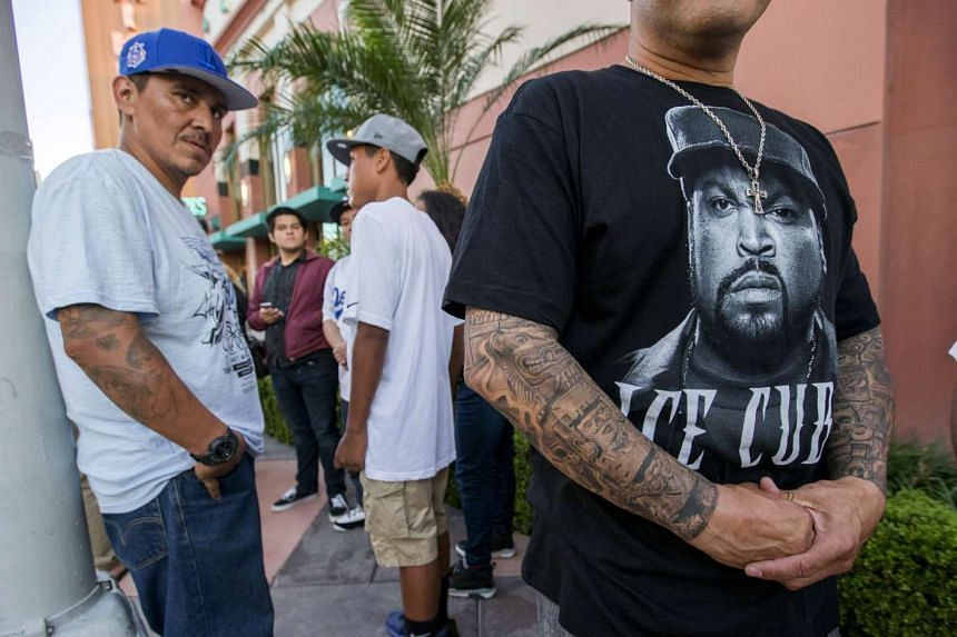 People wait in line for an advanced screening of Straight Outta Compton in Downey, California.