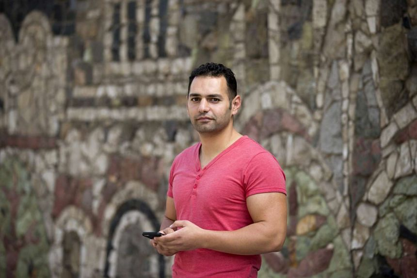 Mohamad Abou Assaf, a refugee from Syria, poses for a picture in Dresden, Germany on Sunday. Despite almost daily reports of hostility towards migrants, The 29-year-old Syrian, who arrived in Dresden five months ago after travelling overland through