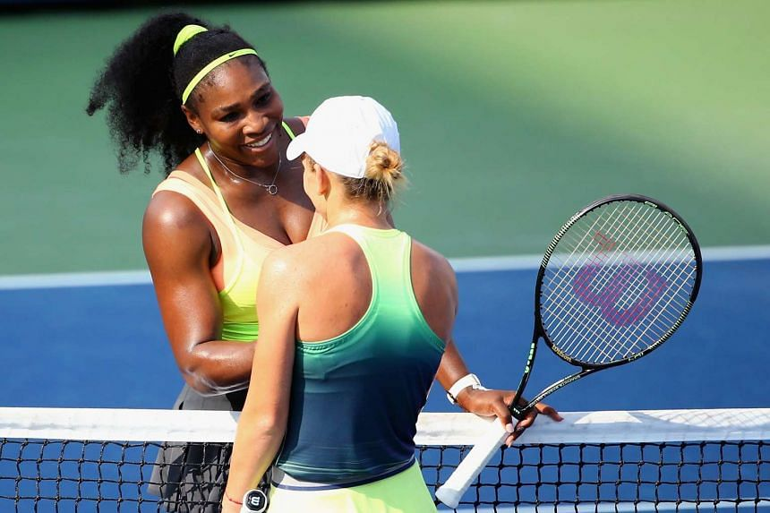 Serena Williams shakes hands with Simona Halep of Romania after their final round match at the Cincinnatii Masters in Ohio on Sunday.