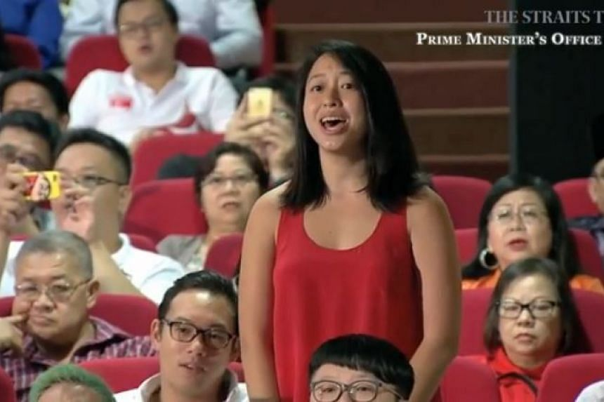 Singaporean Wu Jiezhen on her feet singing along to Kit Chan's Home at the National Day Rally.