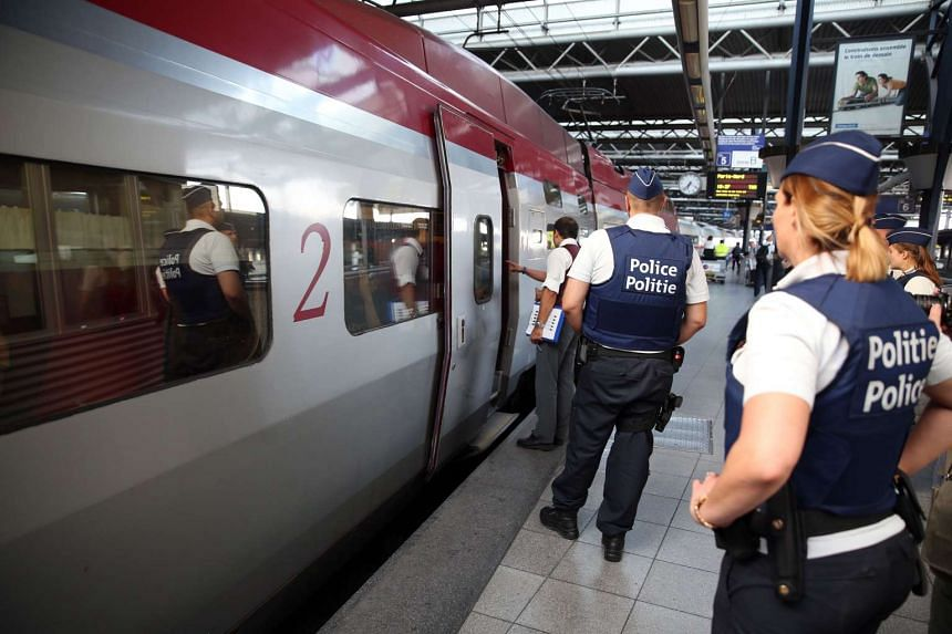 Police officers stand on the platform at the Zuid-Midi railway station in Brussels, on Aug 22, 2015.