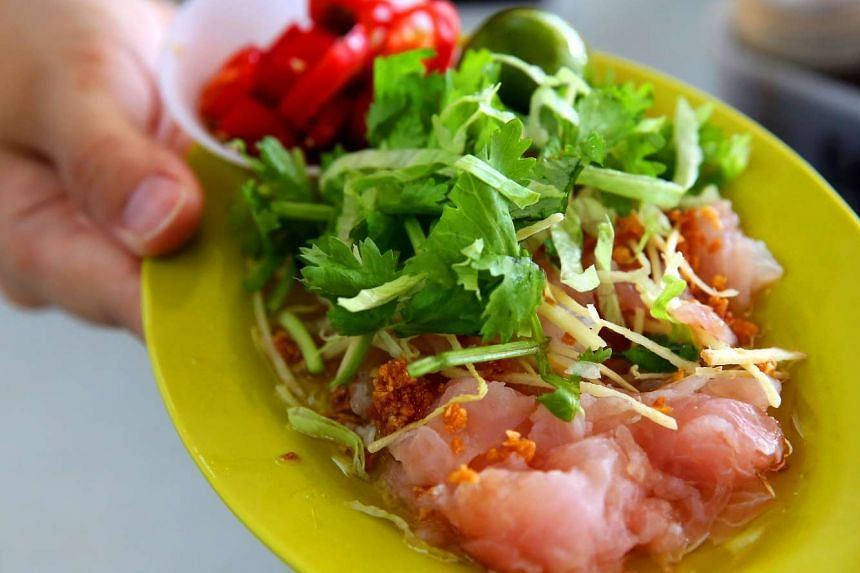 A raw fish dish from a hawker stall.
