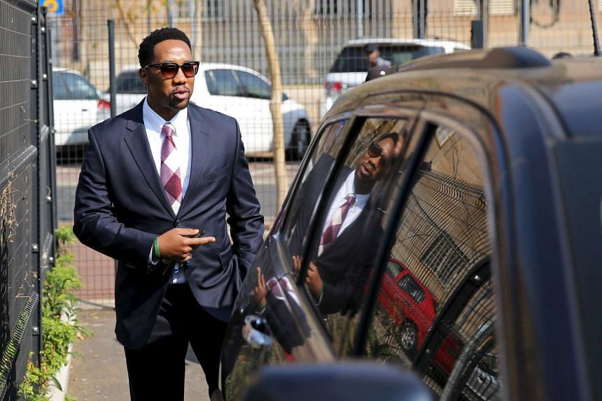 Ndaba Mandela, a grandson of late former South African president Nelson Mandela, leaves the Johannesburg court on Aug 25, 2015.