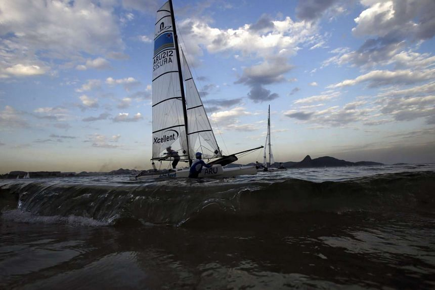 Competitors leaving the Guanabara Bay waters after taking part in Nacra 17 class during the Aquece Rio International Regatta on Aug 19, 2015.