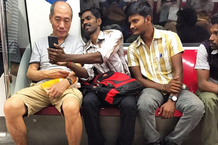 Mr Saravanan asks if he can take a selfie with Mr Lau.