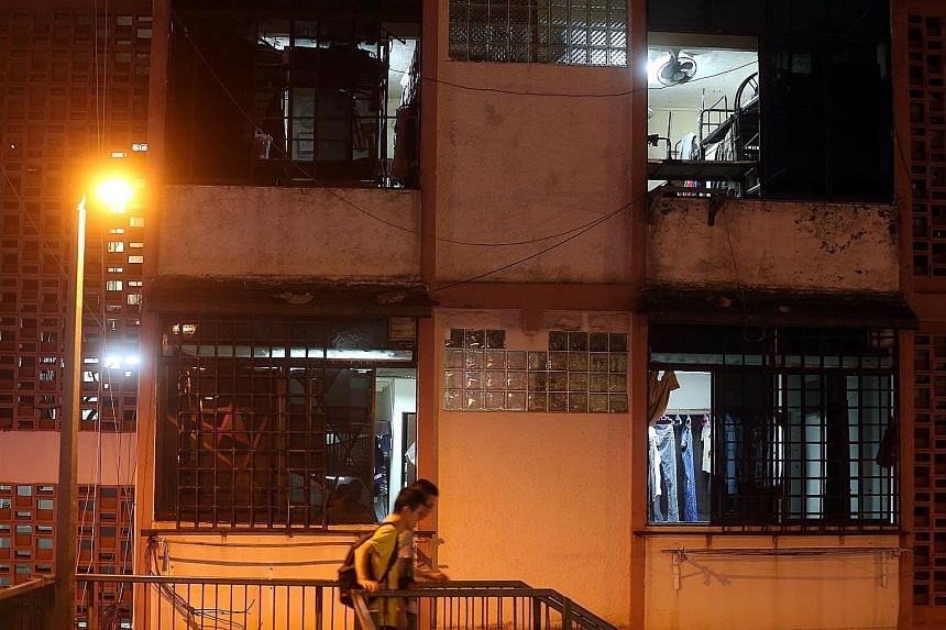 Foreign workers continue to live in Geylang homes that have been converted into dormitories illegally.
