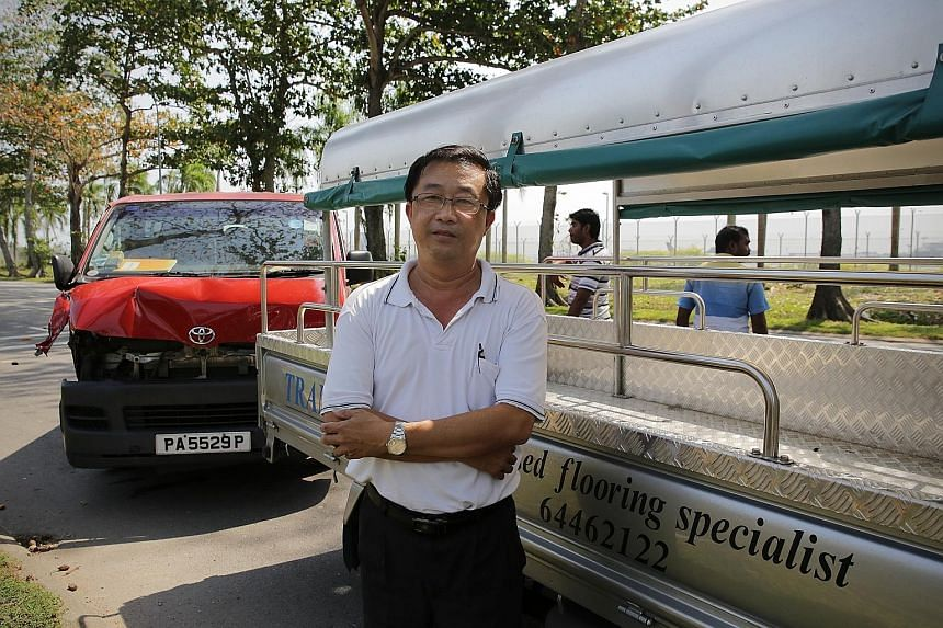 Mr Heng Ngee Seah's lorry was hit by a van trying to execute an illegal U-turn along Changi Coast Road last week. The Traffic Police recorded 129 traffic violations by heavy vehicles there last year.