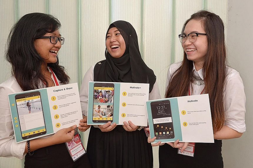 Team 3osy - (from left) Ms Siti Nur Anisha Mohamad Jani, Ms Nur Shafiqah Suhaimi and Ms Quenna Tan Hui Shan - created the app Happy Working Lor, which offers motivational quotes from users working in various professions, to encourage Singaporeans to