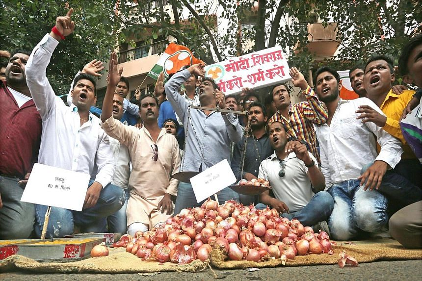 Congress party workers in Bhopal protesting against onion prices, which soared to two-year highs in India's largest onion market in the state of Maharashtra.