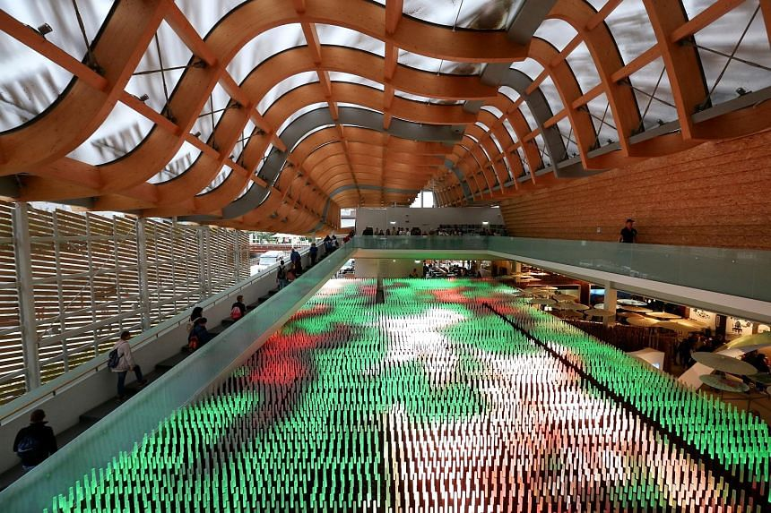 Visitors passing by a giant light installation inside the China pavilion at Expo 2015 in Milan, Italy, on Sunday. Milan won the bid in 2008 to host the international event that officials estimated at the time could generate €3.7 billion (S$5.9 bill