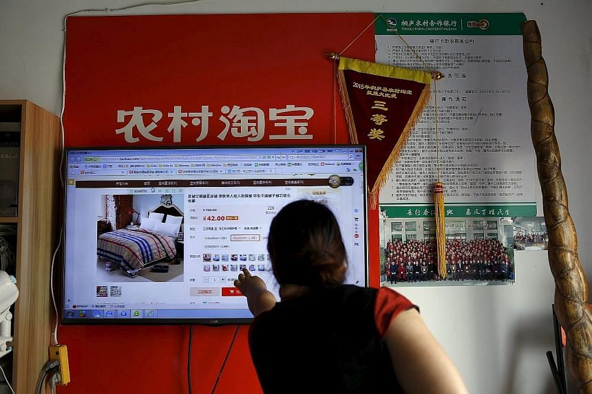 A customer checking out a website of Alibaba's Taobao at a rural service centre in Yuzhao Village in Zhejiang province. The Chinese e-commerce giant has had lacklustre performance in the past year, with the group missing earnings consensus in each of