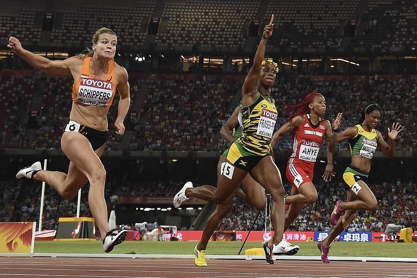 Shelly-Ann Fraser-Pryce (centre) holds off Dafne Schippers (left) to secure gold in the 100 metres. Schippers recently switched to the sprints from the hepathlon.