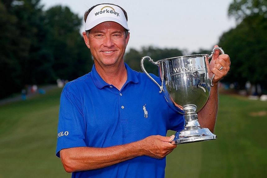 Davis Love with the Sam Snead Cup after winning the Wyndham Championship on Sunday, his first Tour victory since 2008.