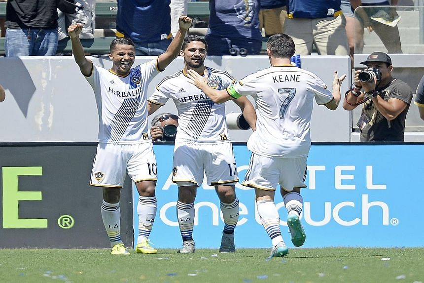 Giovani dos Santos (No. 10) of Los Angeles Galaxy celebrates his goal with team-mates Robbie Keane (No.7) and Sebastian Lletget (No. 17) against New York City FC.