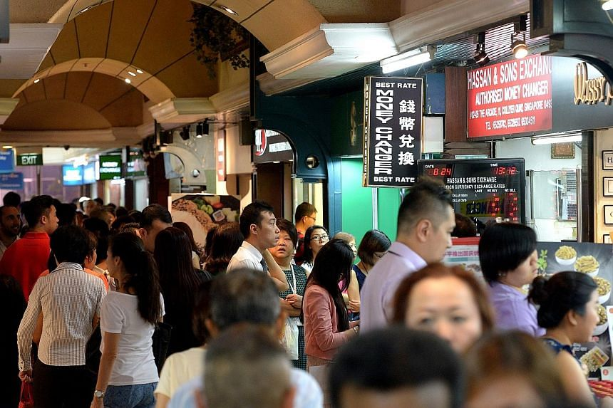 The Malaysian ringgit's free fall against the Singapore dollar stood out amid yesterday's global rout of currencies, stocks and commodities. For the first time, one Singapore dollar could fetch RM3 in foreign exchange trading. Long queues formed at m