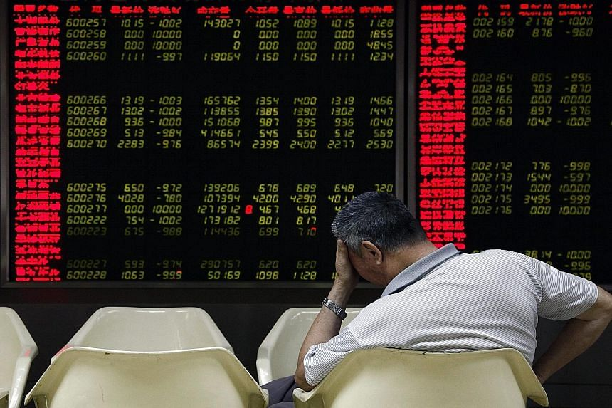 An investor monitoring stock data in Beijing yesterday. Jumpy investors see the latest market turmoil as a potential forerunner of a new full-blown crisis.