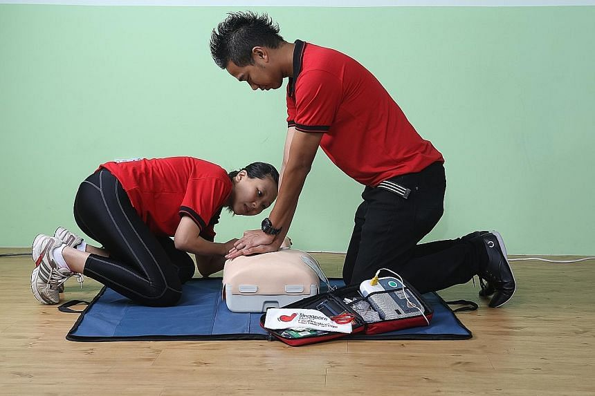 Participants in a training class practising cardiopulmonary resuscitation, to be used alongside the automated external defibrillators.