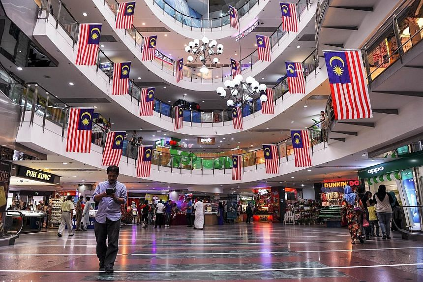 Malaysian national flags adorning a shopping mall in Ampang, Kuala Lumpur, ahead of the country's Independence Day celebrations on Aug 31.