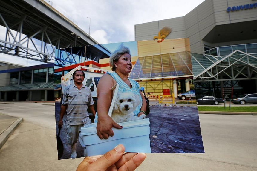 Photographer Carlos Barria holds a print of a photograph he took in 2005, as he matches it up at the same location 10 years on, in New Orleans, United States on Aug 17, 2015.