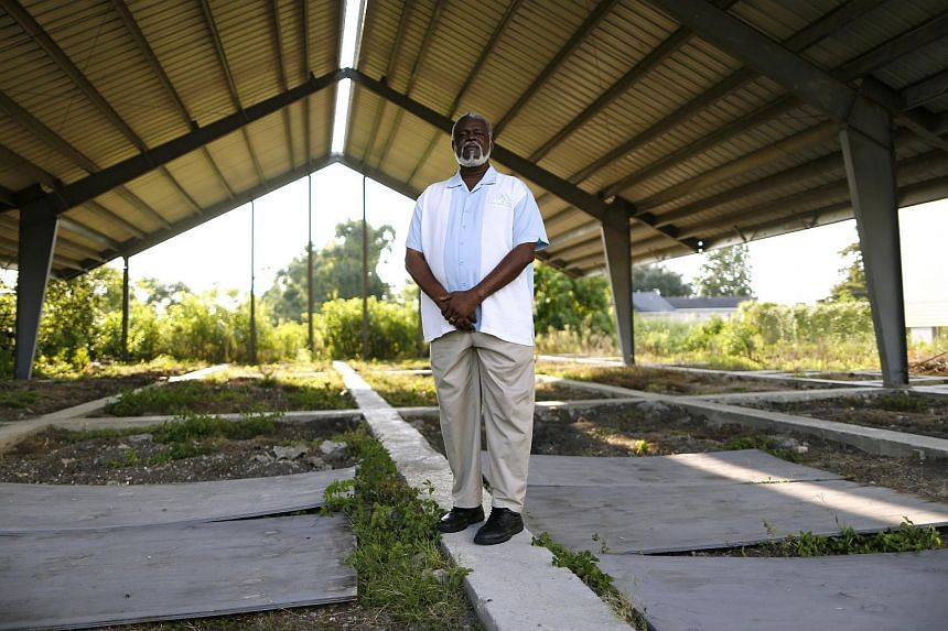 Reverend Charles Duplessis poses for a picture at the construction site of his fellowship's new church, the Mount Nebo Bible Baptist Church, in the Lower Ninth Ward neighbourhood of New Orleans, Louisiana on July 31, 2015.