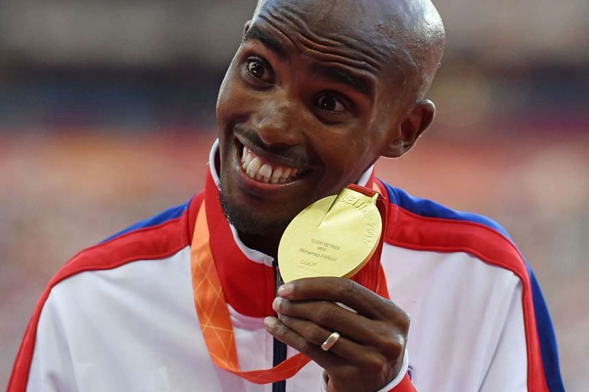 Mo Farah celebrating during the victory ceremony for the men's 10,000m athletics event at the 2015 IAAF World Championships on Aug 23, 2015.