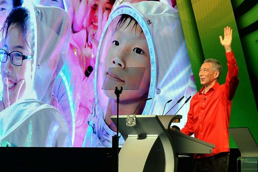 Politicians, including Prime Minister Lee Hsien Loong, reacted after the Writ of Election was issued on Aug 25, 2015.  He is seen here at the National Day Rally on Aug 23.