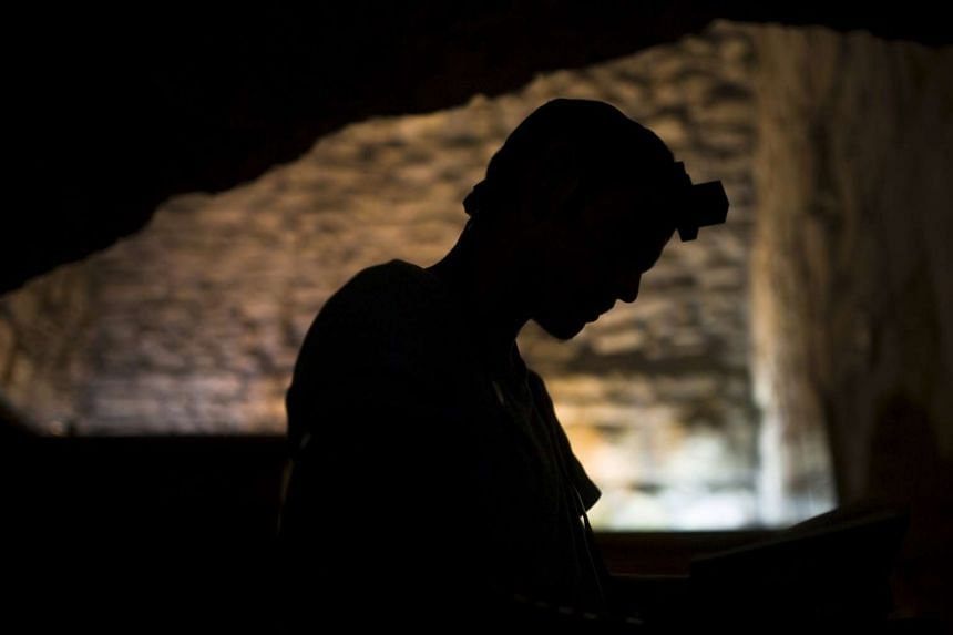 A Jewish worshipper praying in Jerusalem's Old City.