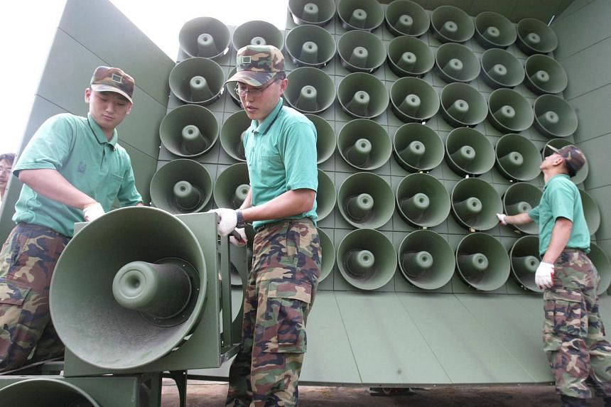South Korean soldiers installing loudspeakers at a unidentified site on the western front-line bordering North Korea on Aug 11, 2015.