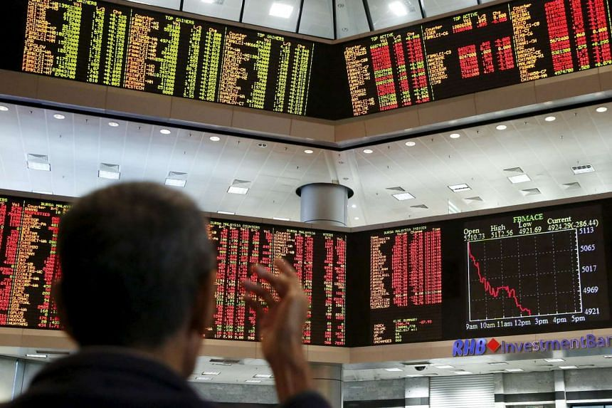 An investor monitoring share market prices at a brokerage firm in Kuala Lumpur, Malaysia, on Aug 24, 2015.