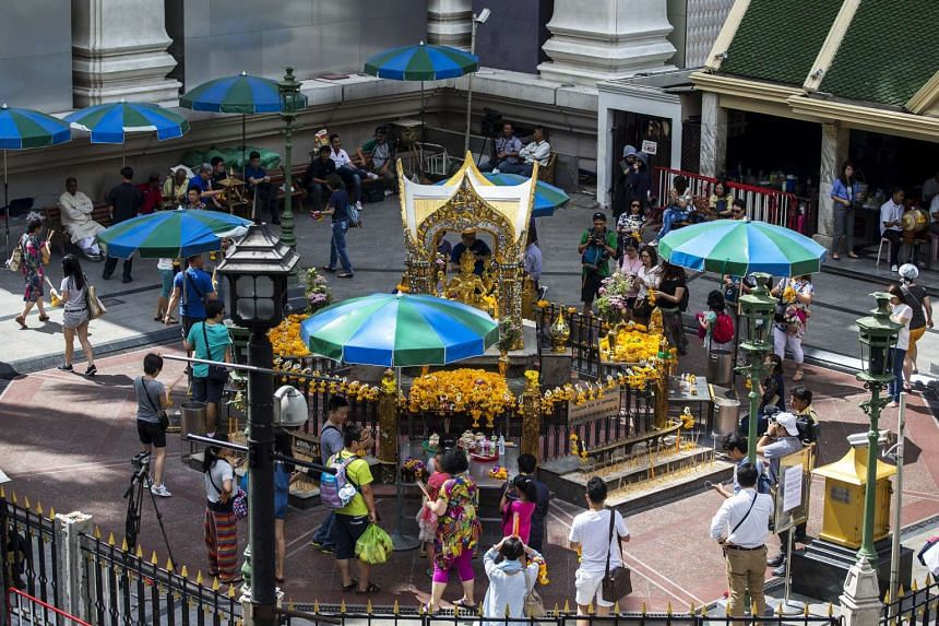 People and tourists gather as they pray at the Erawan shrine, the site of last Monday's deadly blast, in Bangkok, Thailand on Aug 24, 2015.