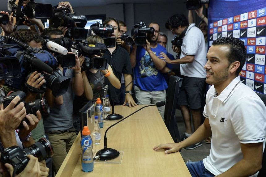 Barcelona's former forward Pedro Rodriguez sits during a farewell press conference for his departure from the club to English football team Chelsea at the Sports Center FC Barcelona Joan Gamper in Sant Joan Despi, near Barcelona on Aug 24, 2015.