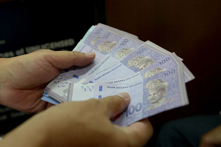 The Malaysian unit fell about 1.4 per cent to settle at 3.0166 to one Singapore dollar.